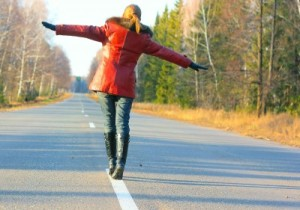 young-girl-walking-on-asphalt1